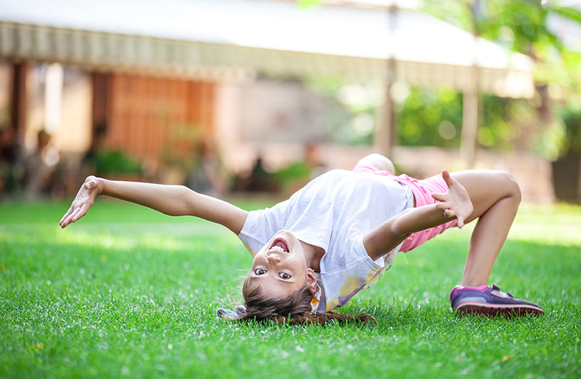 a girl playing on the grass